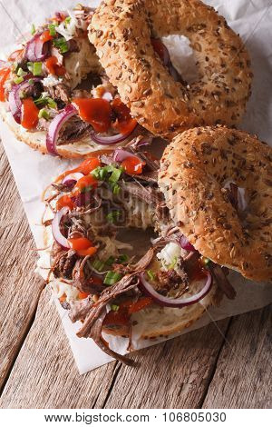 Bagels With Pulled Pork, Onions And Slaw Close-up. Vertical