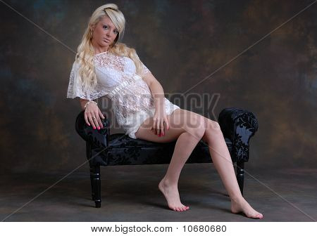 photograph of pretty young woman in white lace outfit poster
