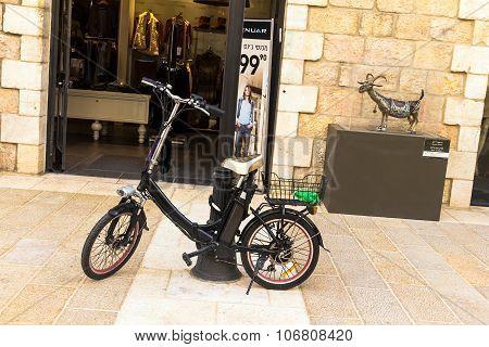 Electric Bike Near  Open Door Of Shop  At Mamilla Street In Jerusalem