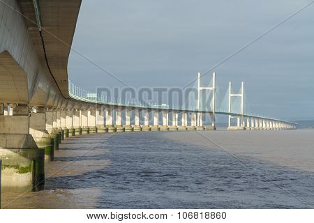 The Second Severn crossing is a bridge that carries the M4 motorway over the Bristol Channel or River Severn Estuary between England and Wales United Kingdom. Morning light from East. poster