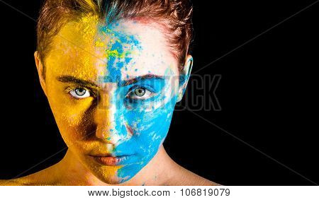 Woman Covered With Yellow And Blue Paints