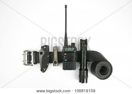 Folding Knife, Radio Transmitter A Flashlight And A Taser On A Black Leather Strapthe