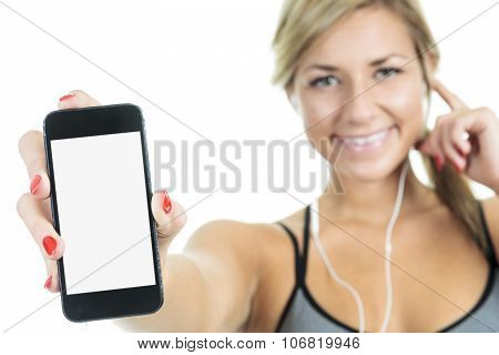 Fit woman stretching her leg to warm up - isolated over white ba