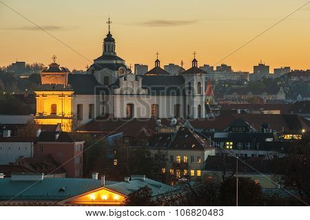 Vilnius, capital city Lithuania:  Aerial view of Church of the Holy Spirit, Sventosios Dvasios Baznycia, in the sunset poster
