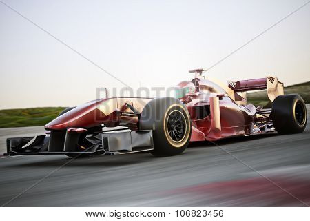 Motor sports race car side angled view speeding down a track with motion blur.