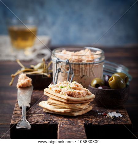 Smoked salmon and soft cheese spread, mousse, pate with crackers.