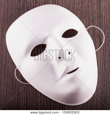 White Mask Over Wood