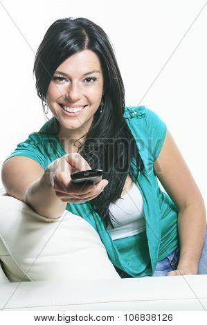 A Beautiful smiling woman relaxing in sofa