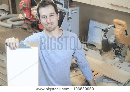A Carpenter working hard at the shop