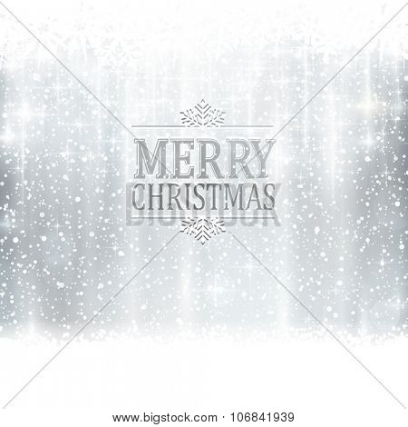 Abstract silver winter, Christmas card with snowflakes, snowfall, out of of focus light dots, stars and light effects and the wording Merry Christmas. Copy space