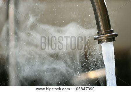 Hot Steaming Water Running From Kitchen Faucet