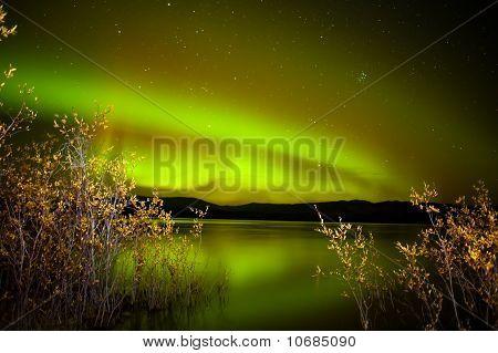 Northern Lights Mirrored On Lake