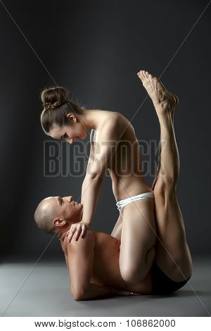 Sex and yoga. Half-naked couple training in studio