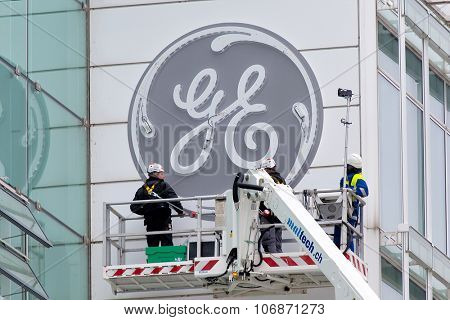 BADEN, SWITZERLAND. November 2nd 2015. Lighting tests during the installation of the new General Electric logo at the former Alstom thermal power headquarters.