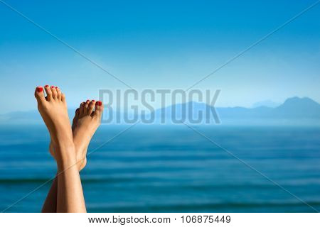 Feet of girl on the background of mountains.