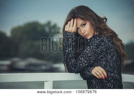 beautiful young long hair woman in cardigan, outdoor autumn day portrait