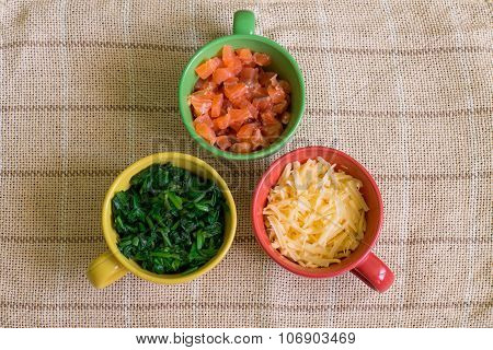 Ingredients in colorful cups