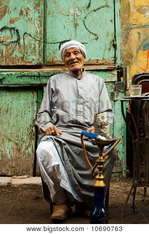 Elderly Egyptian Smoking Sheesha