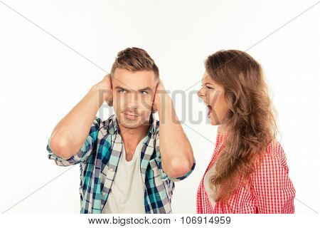 Annoyed young woman shouting at her boyfriend poster