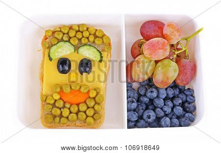 Creative sandwich and fruits in lunchbox isolated on white background