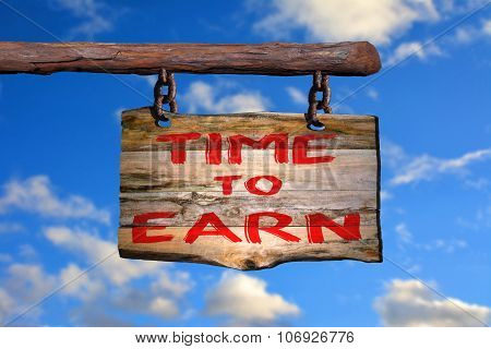 Time to earn sign with blurred background poster