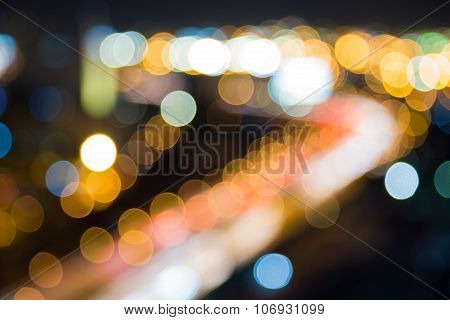Night view of city highway road curved, abstract blurred bokeh background