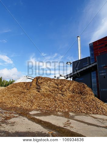 bio power plant with storage of wooden fuel (biomass) against blue sky poster