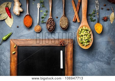 Various Spices Near Blackboard