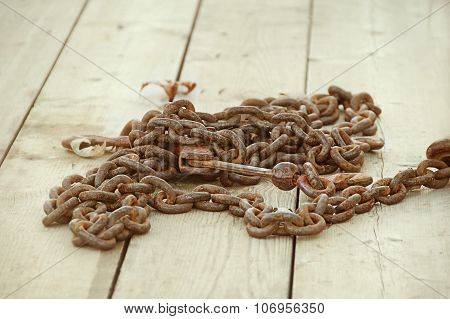 Rusty Linked Chain with Hook on Deck