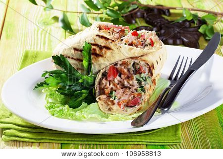 shawarma in pita bread on a plate small still-life green board restaurant beauty appetizing atmosphe