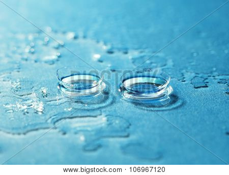 Contact Lens On The Blue Background