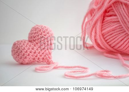Little crochet heart and a skein of yarn