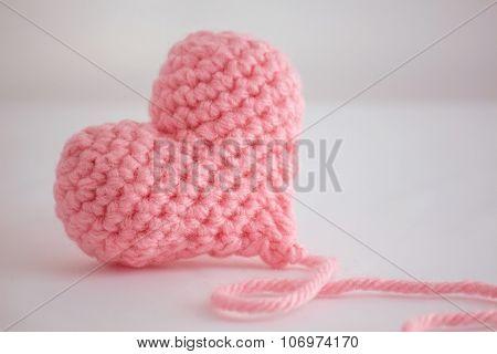 Beautiful warm pink crocheted heart - closeup
