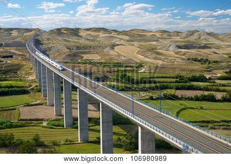 view of a high-speed train crossing a viaduct in Roden, Zaragoza, Aragon, Spain. AVE Madrid Barcelona.