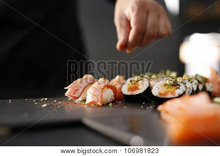 Sushi master preparing sushi in Japanese restaurant