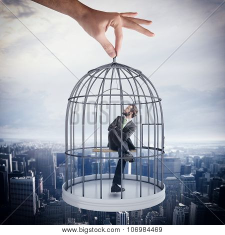 Caged  businessman
