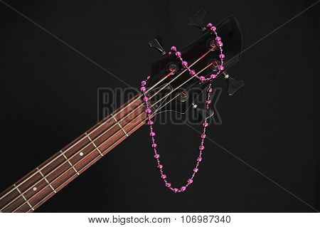 bass guitar headstock with beads