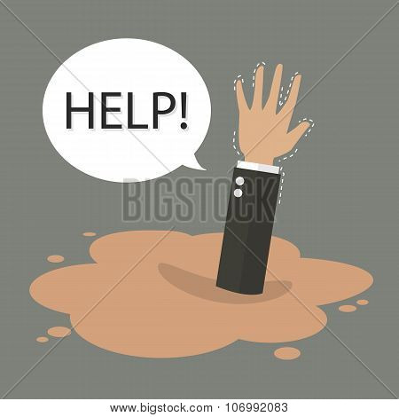Businessman Hand Sinking In A Puddle Of Quicksand