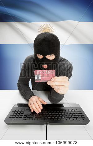 Hacker With Flag On Background Holding Id Card In Hand - Argentina