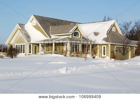 A family home snowed in after a snow storm.