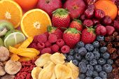 Fruit superfood background with fruits high in antioxidants, vitamin c and dietary fibre.   poster
