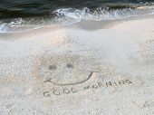 beach coastline with good morning happy face drawn in sand poster