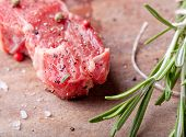 Raw meat, mutton, lamb rack with fresh herbs on a wooden background poster