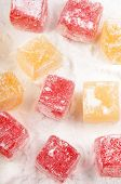 red and yellow turkish delight with powdered sugar poster