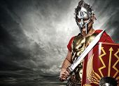 Picture of a legionary soldier over stormy sky poster