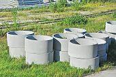 Concrete circle pit block on factory yard poster