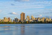 Views of the Upper East side from the west side of the Central Park Reservoir during an autumn evening poster