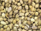 whole pistachios stored in a mass background texture poster