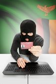 Hacker with ID card in hand and flag on background - Zambia poster