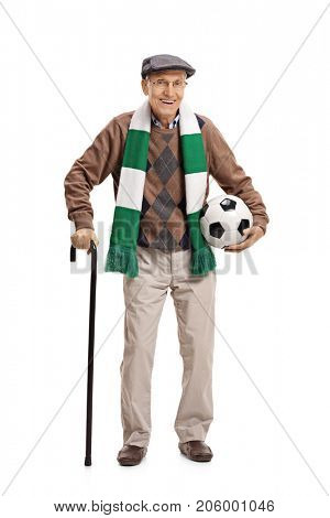 Full length portrait of an elderly soccer fan with a scarf and a football isolated on white background